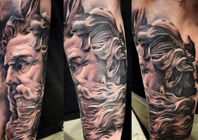 zeus portrait tattoo on arm
