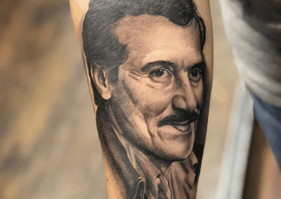 man's portrait tattoo