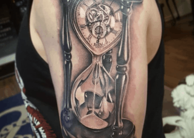 hourglass with clock in the top tattoo