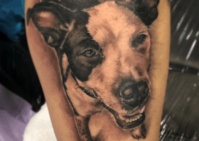 dog head and body tattoo