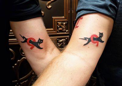 black cat jumping through number 9 tattoo