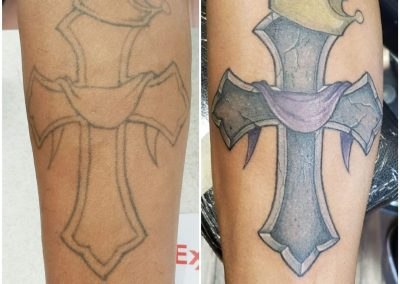tattoo of cross with crown and robe