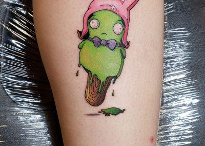 green character tattoo