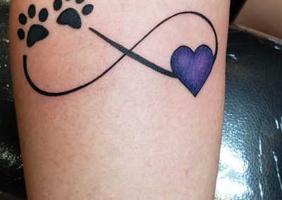 paw prints and heart with inifinity sign tattoo