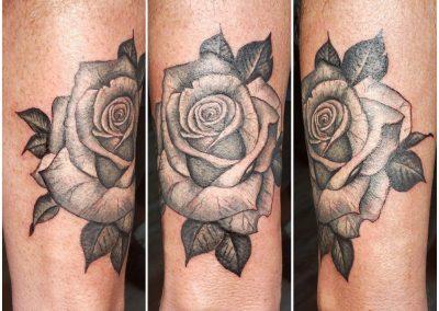 rose tattoo on forearm