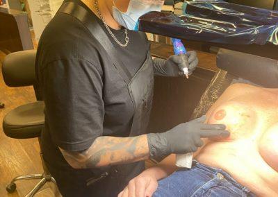 tattoo artist begins a 3D areola tattoo
